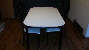 Used Dinning room table with 4 chairs