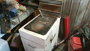 Fawcett wood stove in great cond.needs paint