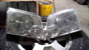 LEFT AND RIGHT HEADLIGHTS FOR 2004 FORD EXPLORER Windsor Region Ontario image 1