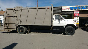GMC 7500c top kick 25 yard rear compactor garbage truck