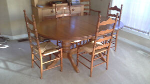 Solid maple dining room table with 4 side chairs & 1 arm chair