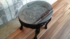 Carved wood table with glass top
