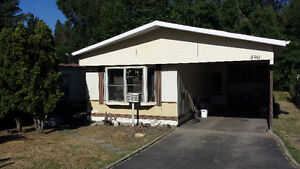 Coldstream BC manufactured home on titled lot.