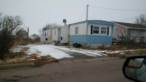 trailer and land,10000,need renovation,trades accepted