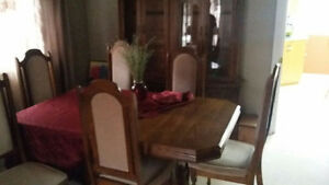 Dining table and chairs and hutch