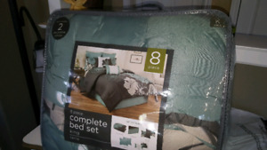 King sized 8pc. Comforter set with matching curtains .