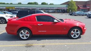 2005 Ford Mustang GT Coupe (2 door) trade for a harley only .