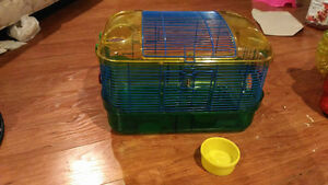 hamster cage with hut and foodbowl