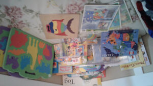 Assorted books and puzzles