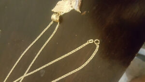 10k 26inch gold chain with 10k gold diamond cut pendant