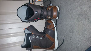 2 snowboards and 2 sets of boots for sale