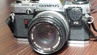 Olympus OM 10 camera and zoom lens