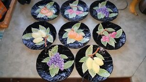 "Beautiful set of 8 ceramic plates with fruit motif, 8"" diameter."