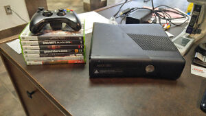 Xbox 360 with one controller and 7 games