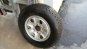 Spare Firestone ATX on Nissan Rim Like New. Never used.