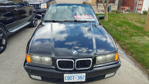 1999 BMW 3-Series 323i Convertible willing to trade.