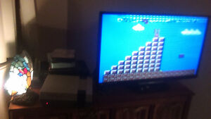 NES - Working, 1 controller, cords, 7 games