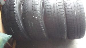 4 snows with rims - 215/65 R16