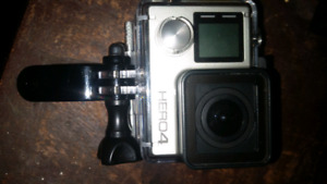 GOPRO HERO 4 SILVER MINT CONDITION USED ONCE.