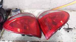 LEFT AND RIGHT TAILIGHTS FOR A 2001-2004 DODGE CARAVAN Windsor Region Ontario image 1