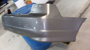 2004 Honda Civic for parts - spare tire, bumper, side mirror... Kitchener / Waterloo Kitchener Area image 1