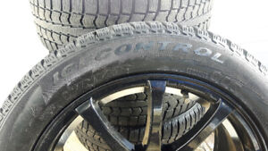 4 Pirelli Tires with Mags (225/50 R17 - 98T)
