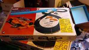 Two Tyco slot car sets