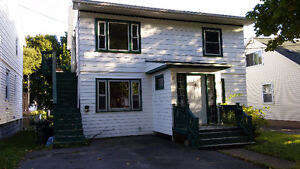 2 Bedroom Flat Includes Utilities in an Awesome Location!