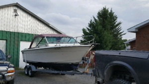 21 Ft Grew boat with cubby cabin and trailer asking 3,500$