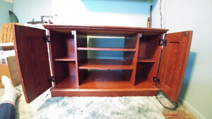 Small wooden entertainment stand