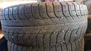 Michelin 195/65 R15 Wintertires on steel rims.