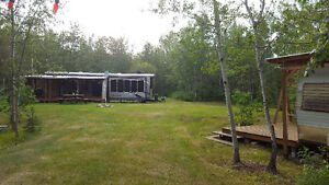 For Sale- Vincent Lake Lakefront lot with 40' trailer