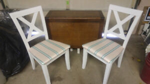 Rustic white folding table and chairs.
