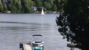 The couples escape cottage with hot tub, fireplace, dock & Lake