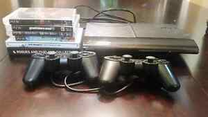 PS3 + 2 controllers + 6 games + cables
