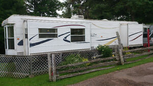 2007 HyLine Park Model for sale 39` plus add-a-room, deck & Shed