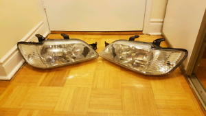 02-03 Mitsubishi Lancer OEM headlights HID Bulbs included