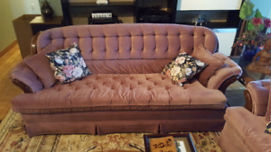 Rose coloured couch, loveseat and chair