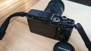 Olympus E-P5 Camera + Olympus M.ZUIKO 40-150mm f/4 - f/5.6 Lens