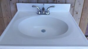 Cultured stone sink with fixtures