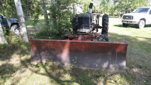 Antique tractor and snowblade