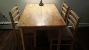 Brown wood dining table with three chairs - can be delivered