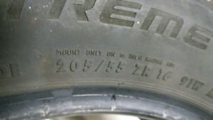 A pair of Extreme Contact all season tires 205 55 16