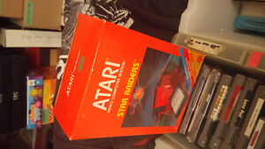Factory sealed atari game with factory sealed control pad