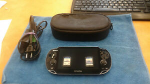 PS VITA CONSOLE AND CORDS + 2 GAMES+CARRY CASE
