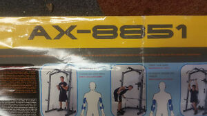 Weightlifters cage bar weights and bench