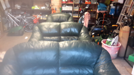 A three two one Green leather suite in good condition.