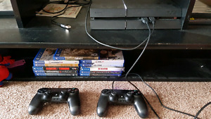 Ps4 w/ 2 controllers and 12 games
