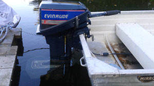 Outboard Motor  Evinrude 15 hp. With a 9.9 cover. And electric s