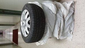 Winter tires with rims and it's cover